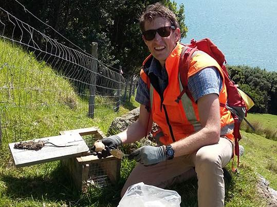 Tauranga City Council's David Grimmer with a rat trap on Mauao.